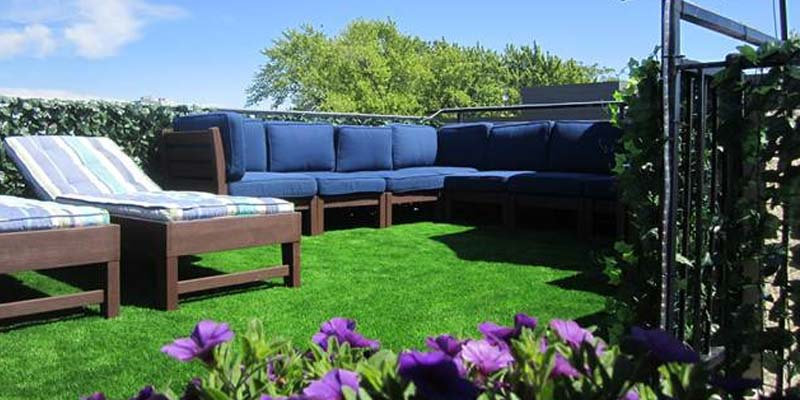 A synthetic grass turf installation with patio furniture at a Chicago home
